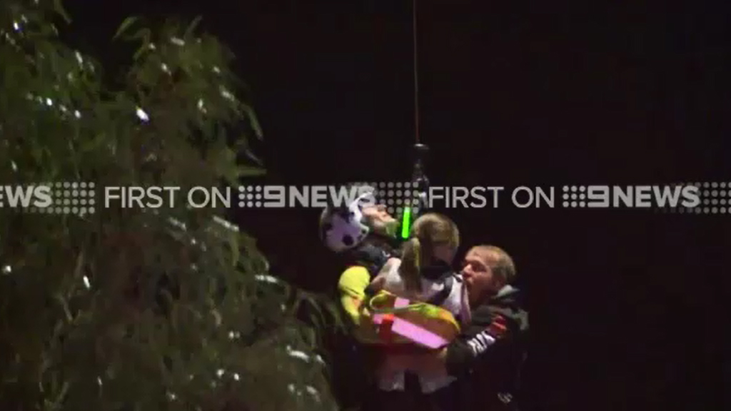 A man and girl were rescued from floodwaters at Inverleigh, west of Geelong. (9NEWS)