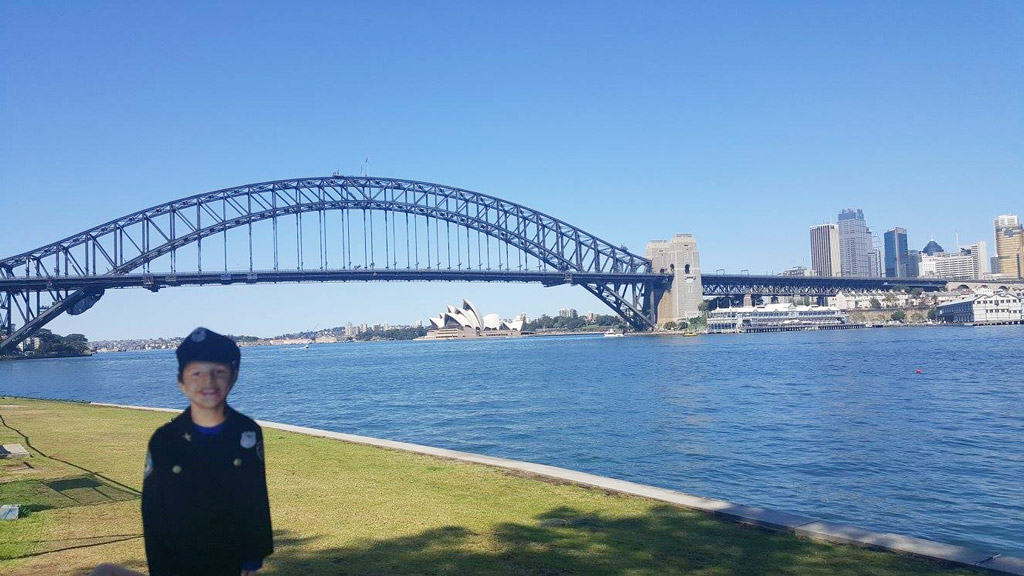 "Flat Caleb ""poses"" with the Sydney Harbour Bridge and Opera House behind him. (Facebook/Harbourside LAC – NSW Police Force)"