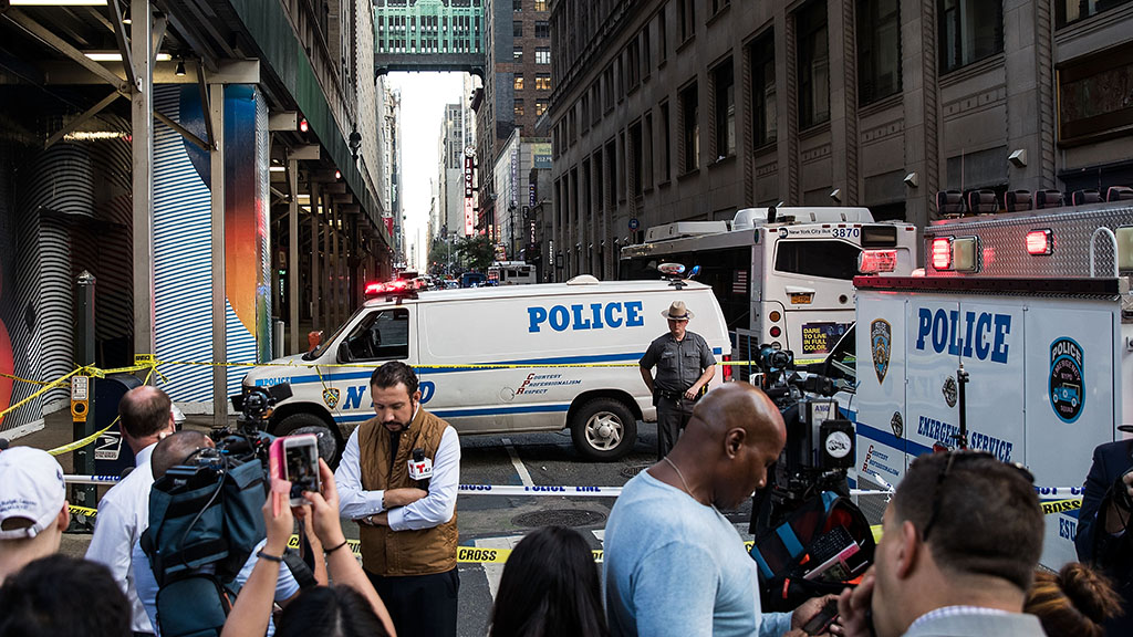 Meat cleaver-wielding man shot at 18 times after attacking New York police officer