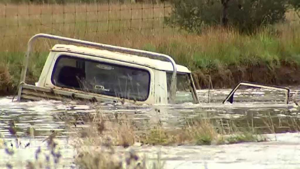 The body is believed to be that of a missing farmer whose ute was swept away by floodwaters on Wednesday.