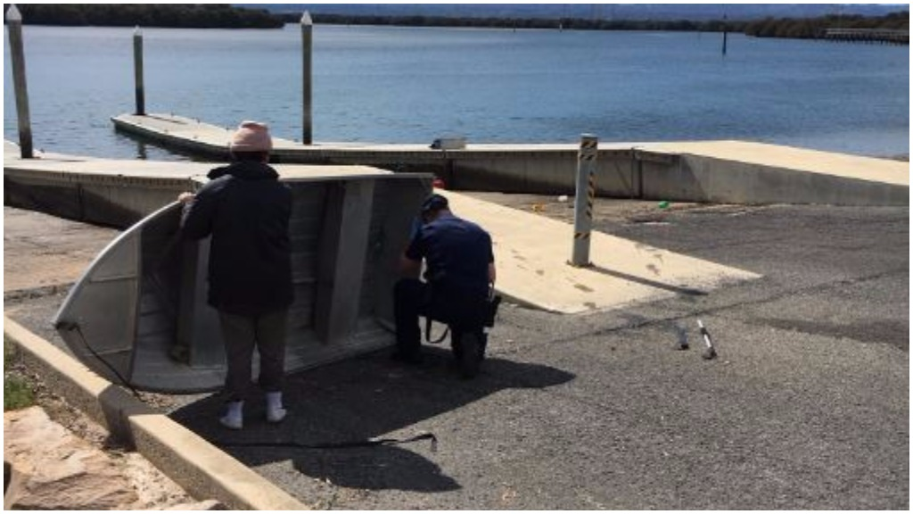 Police divers pulled a machete from the water. (9NEWS)