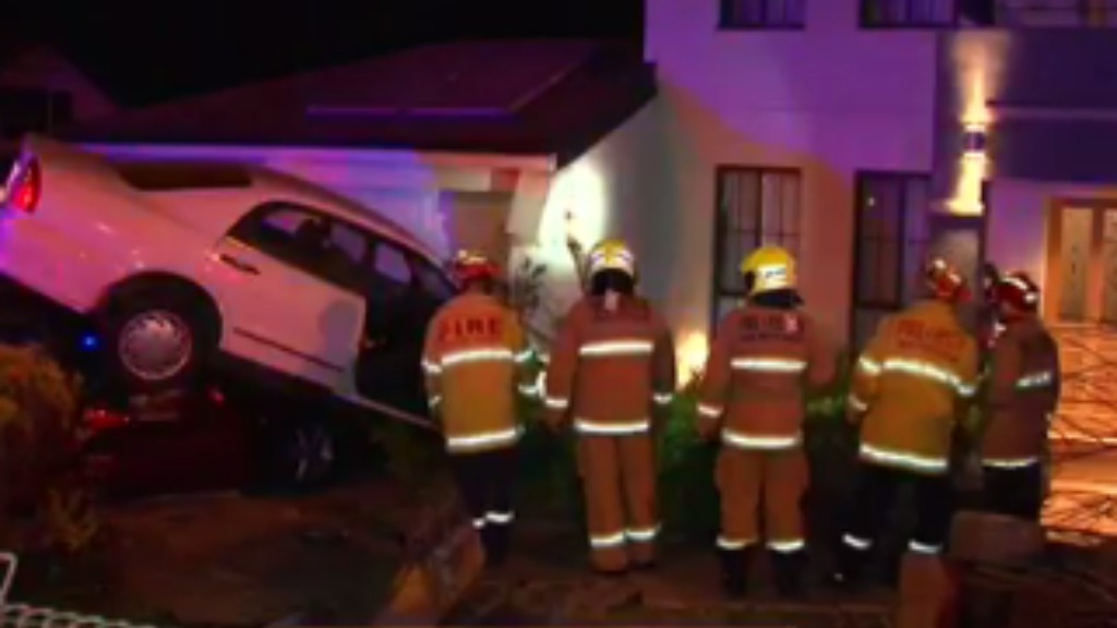 A driver has crashed their car on top of a parked vehicle in Sydney. (9NEWS)