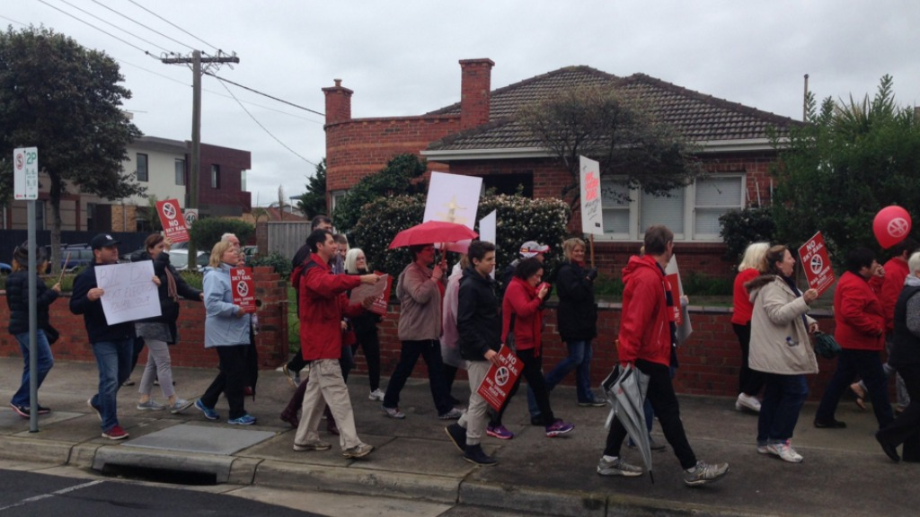 Hundreds march down Melbourne highway in protest of Sky Rail construction