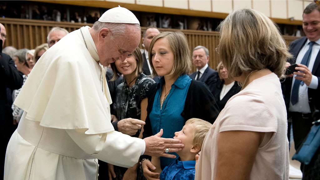 Pope Francis meets with a family during an audience with survivors and relatives of the victims of the July 14 Nice attack. (AFP)