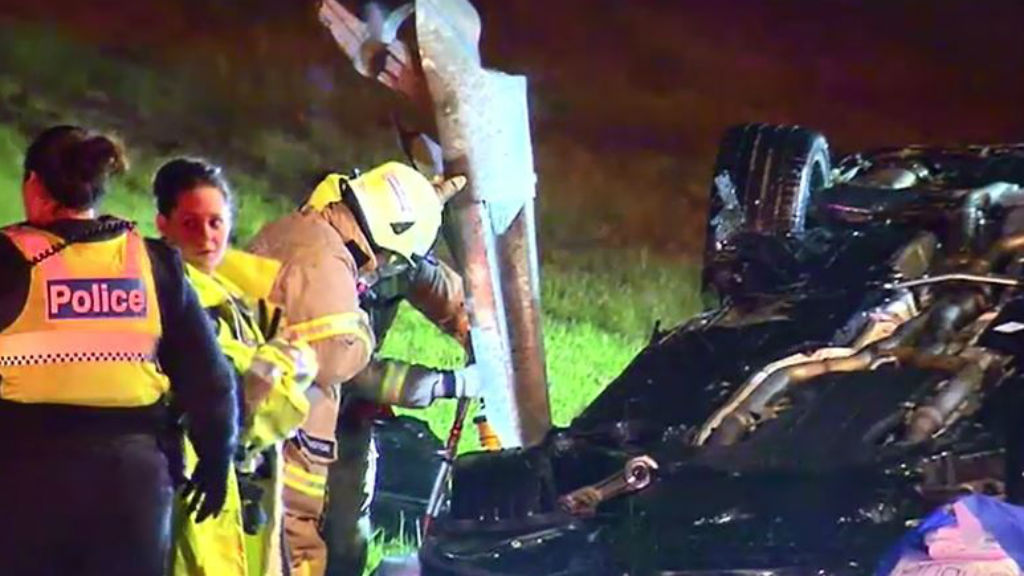 The passenger of a black Mercedes sedan was injured when a guard rail pierced through a car after it rolled on the Western Ring Road. (9NEWS)