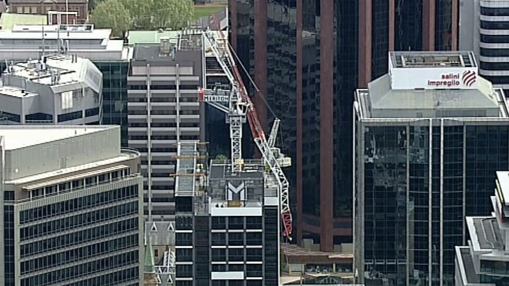 Arthur Street has been closed below the building and motorists are advised to avoid the area. (9NEWS)