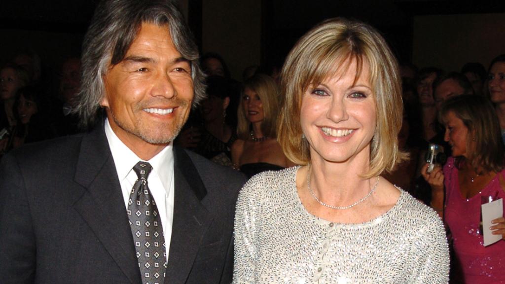 Patrick McDermott and Olivia Newton-John before his 2005 disappearance. (Getty)