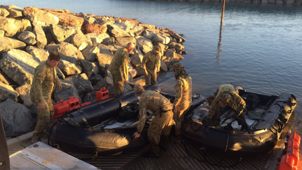 WA army crew searched for Mr Bale using Zodiac boats this morning. (9NEWS)