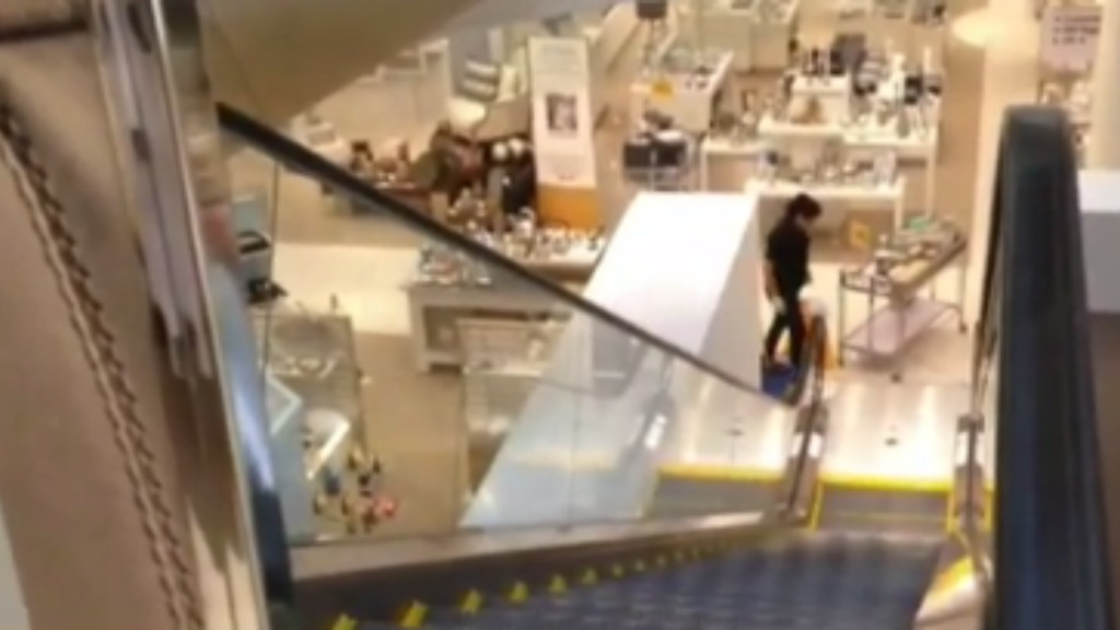 Young boy survives five-metre fall onto escalator at Queensland shopping centre