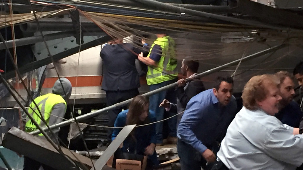 Passengers try to get to safety. (AFP)