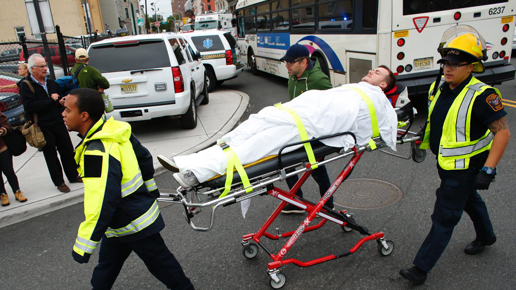 An injured person is taken to hospital. (AFP)