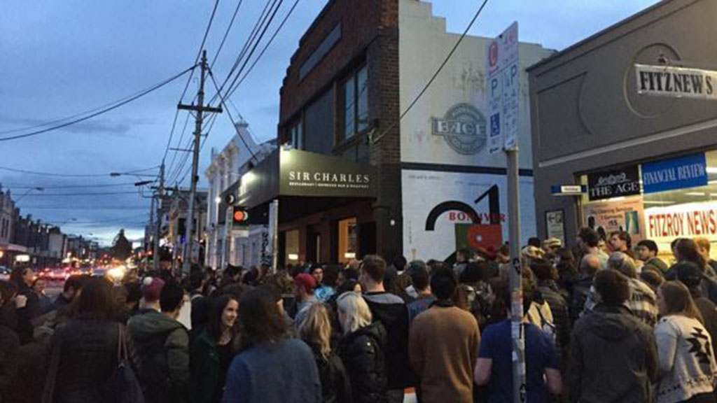 People spilled out onto the street, the crowd so large that many struggled to hear the music. (Instagram: @gabsryan)