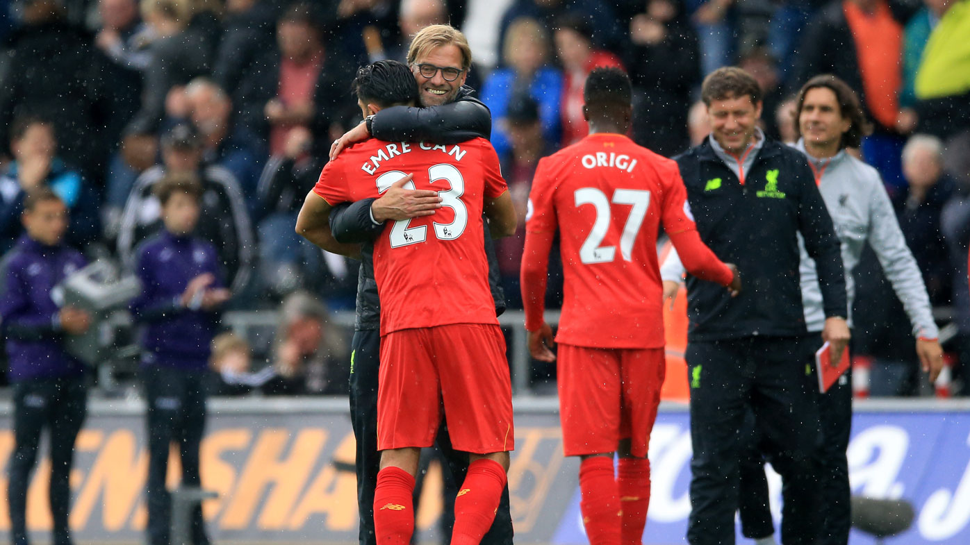 Jurgen Klopp embraces Emre Kahn during the Reds win over Swansea City.(AAP)