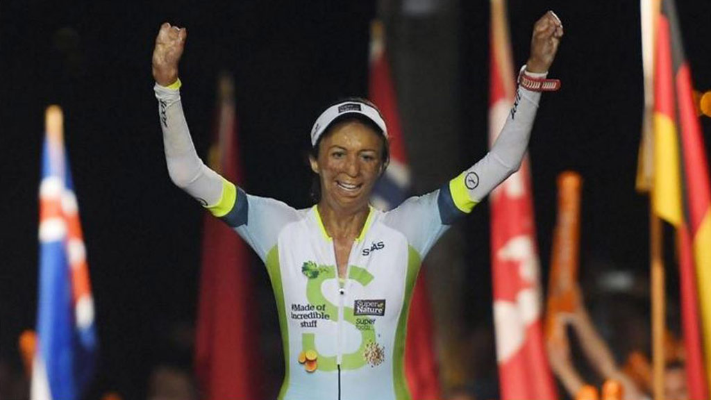 Turia Pitt crosses the finish line. (AAP)