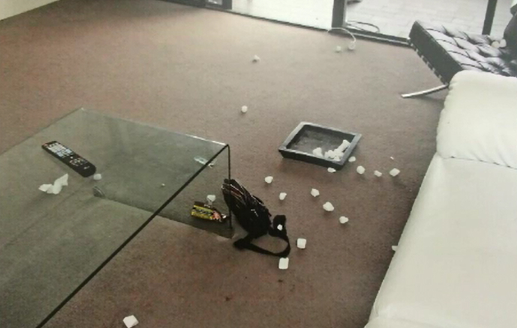 A police photograph of Gable Tostee's apartment taken after Warriena Wright's death shows scattered rocks. (AAP)