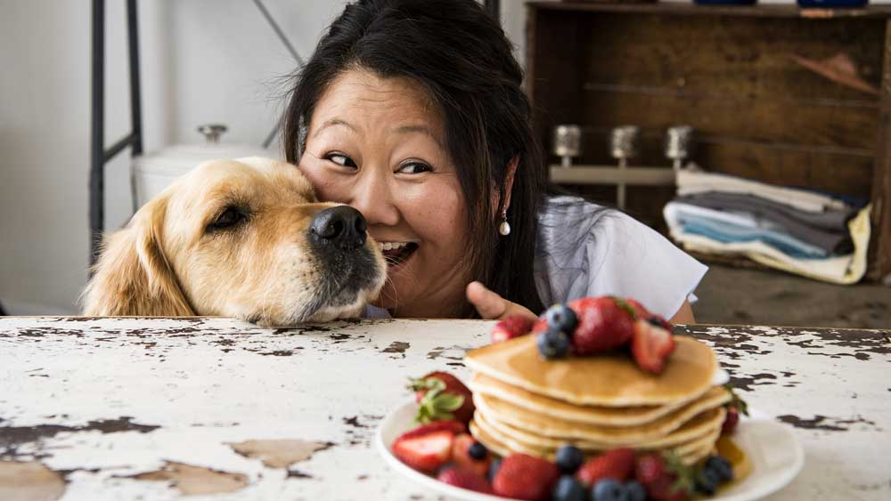 Nagi Maehashi, creator of RecipeTin Eats, pictured with her canine Dozer. Image: Nagi Maehashi