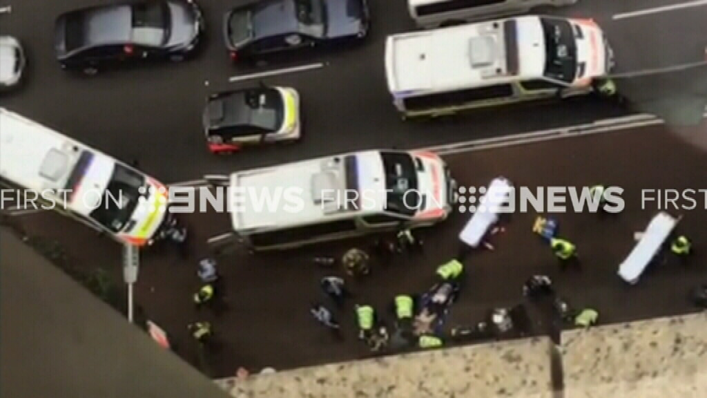 A third man was lucky to escape injury. (9NEWS)