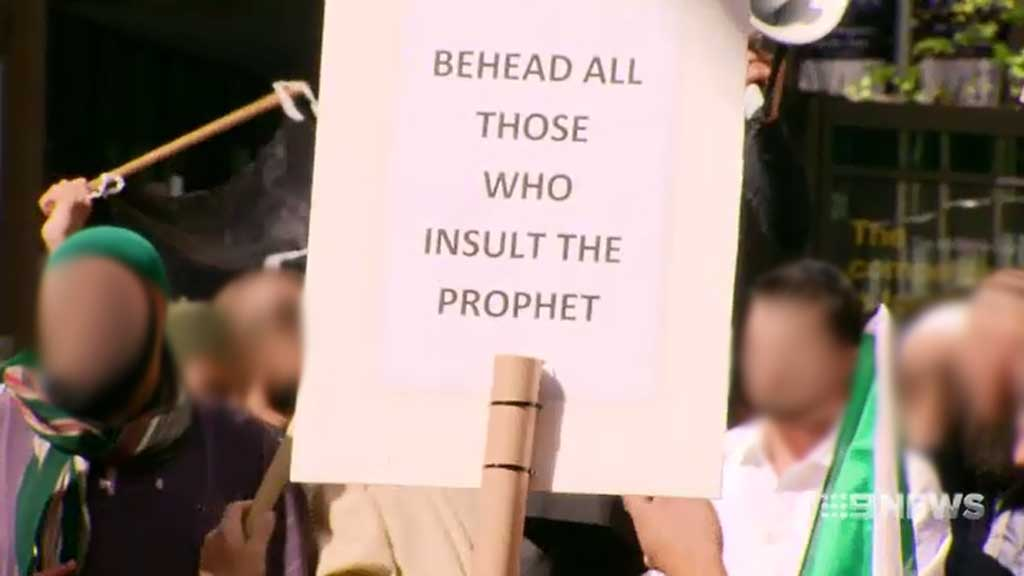 """One of the accused allegedly held a sign reading: """"behead all those who insult the prophet"""" during a protest at Sydney's Hyde Park in 2012."""