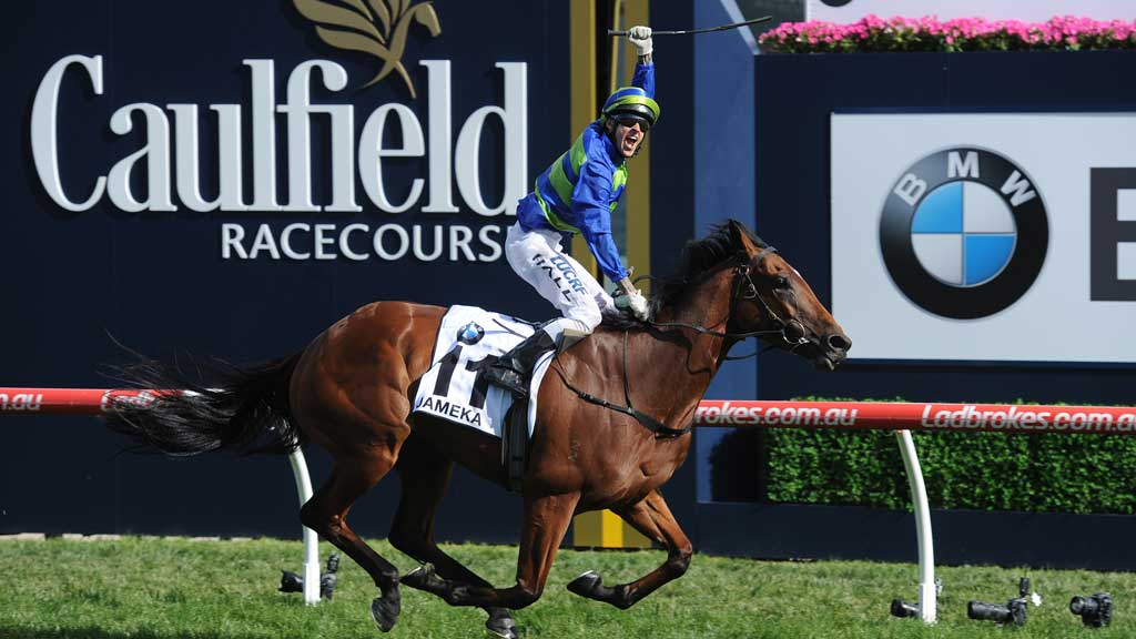 Nick Hall reacts as he rides Jameka to victory in the Caulfield Cup at Caulfield Racecourse in Melbourne. (AAP)