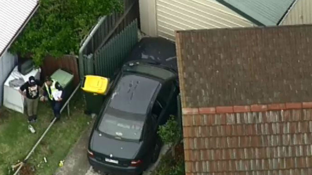 Man suffers spinal injuries and teenager injured after car slams into front yard of Geelong home