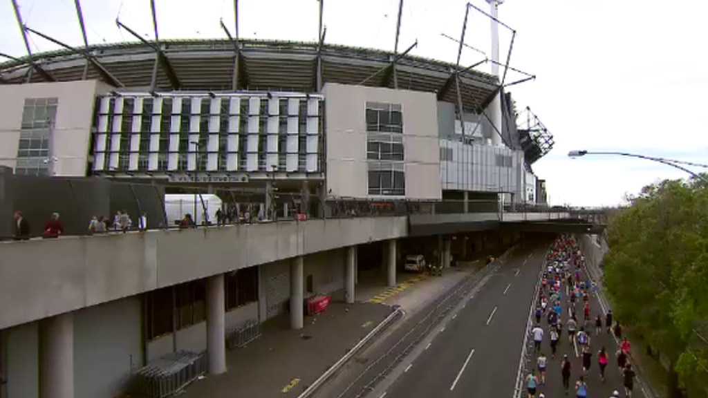 Runners made their way to the finish line at the iconic Melbourne Cricket Ground. (9NEWS)