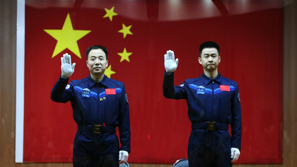 Chinese astronauts Jing Haipeng and Chen Dong. (AAP)