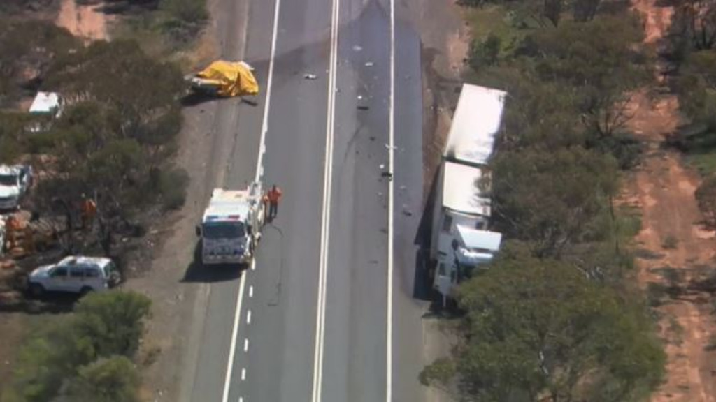 Man dies and woman injured after car collides with truck on South Australia's Sturt Highway