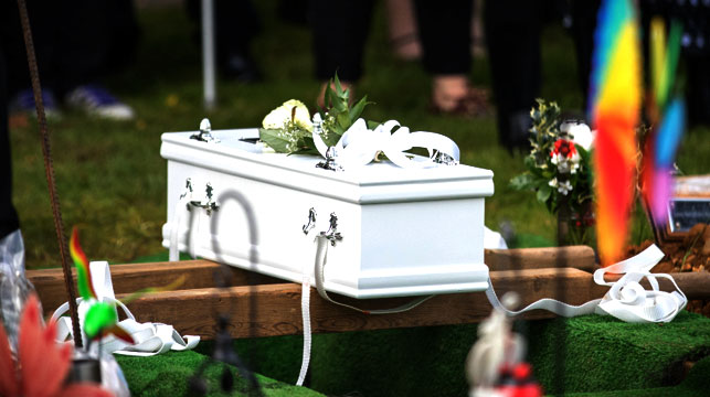 More than 100 strangers attend abandoned baby's funeral