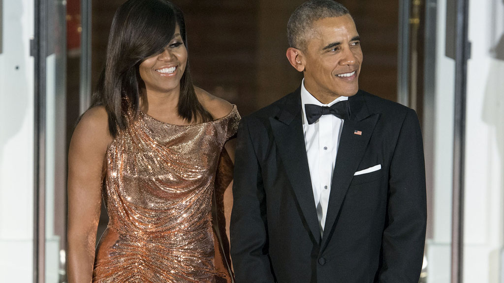 Michelle Obama dazzles in gold for final State Dinner