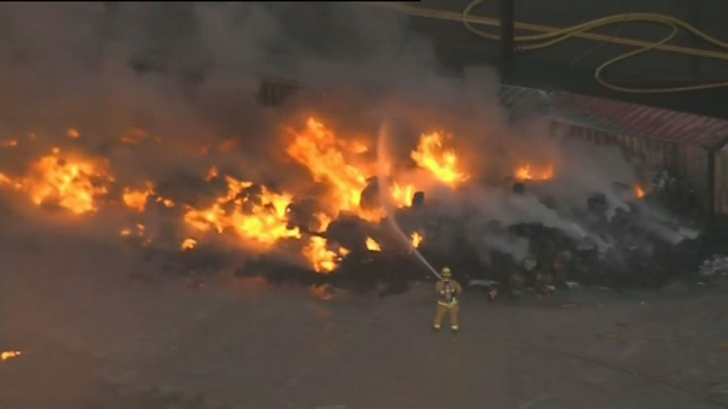 Firefighters are working to protect nearby commercial buildings. (9NEWS)