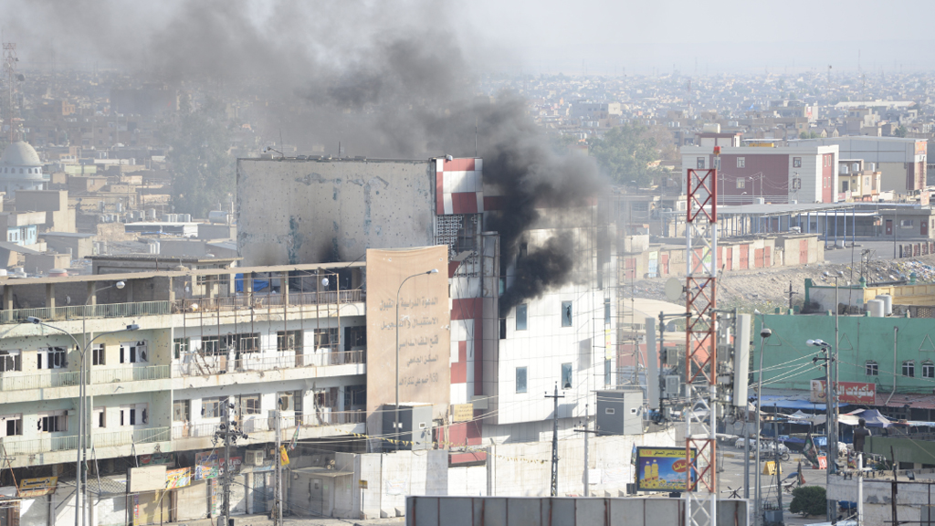 Smoke rises from a building where ISIS fighters had sheltered in Kirkuk. (AFP)