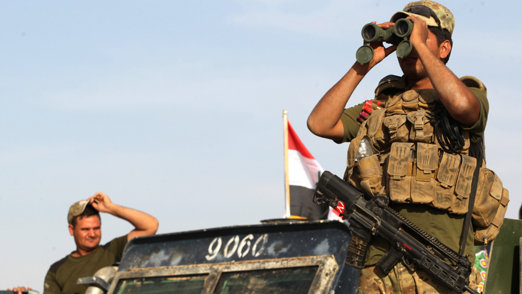 Iraqi forces hold a position about 30km from the ISIS stronghold of Mosul. (AFP)