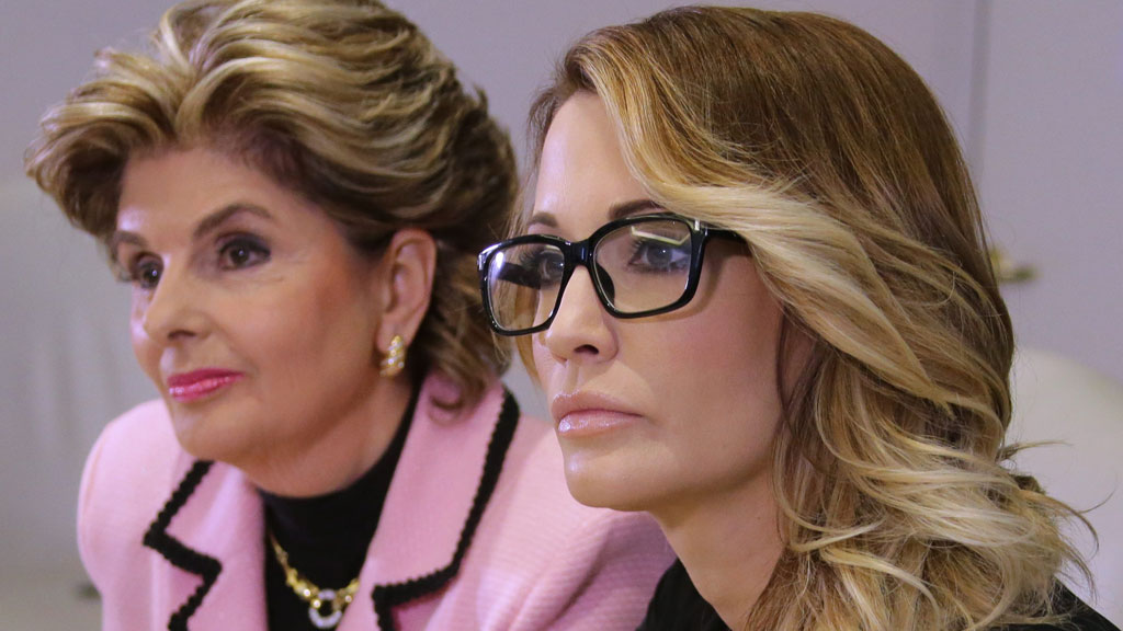 Jessica Drake (R) listens to questions after giving a statement in which she alleges Republican Presidential candidate Donald Trump sexually harassed her at a 2006 golf event in Lake Tahoe at a press conference held by attorney Gloria Allred in Los Angeles, California. (AAP)