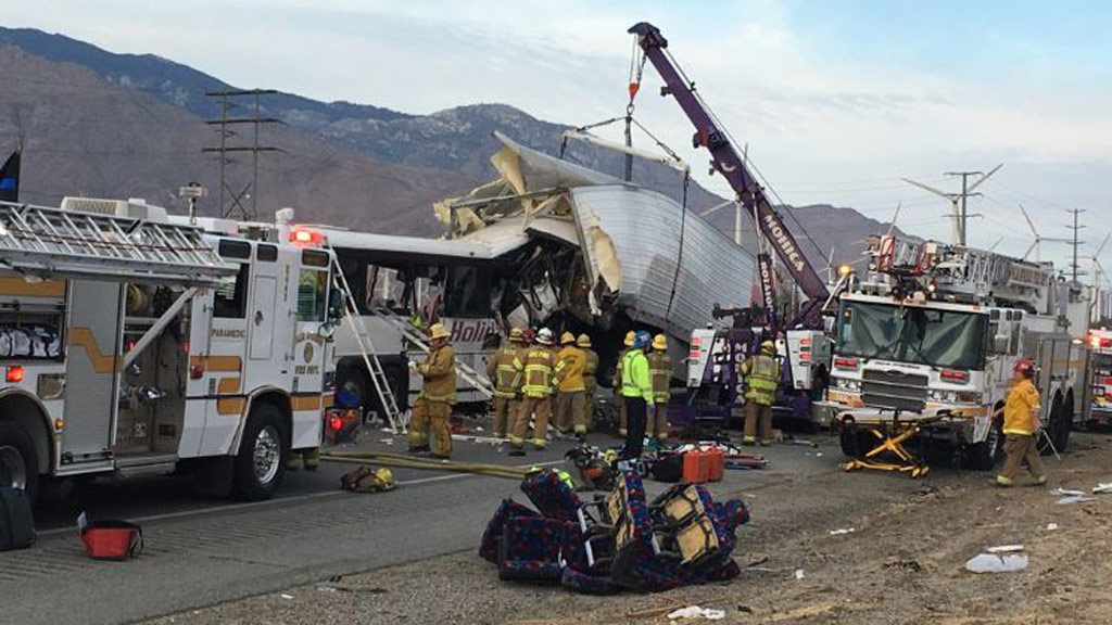 At least 13 dead after tour bus collided with semi-trailer in California