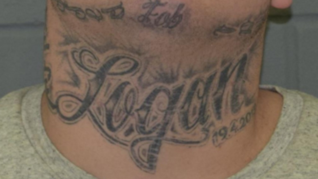 "Jones has several distinct tattoos, including on his neck which bears the name ""Logan'. (SA Police)"