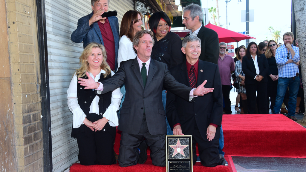 Hugh Laurie reacts as his star on the Hollywood Walk of Fame is unveiled. (AFP)