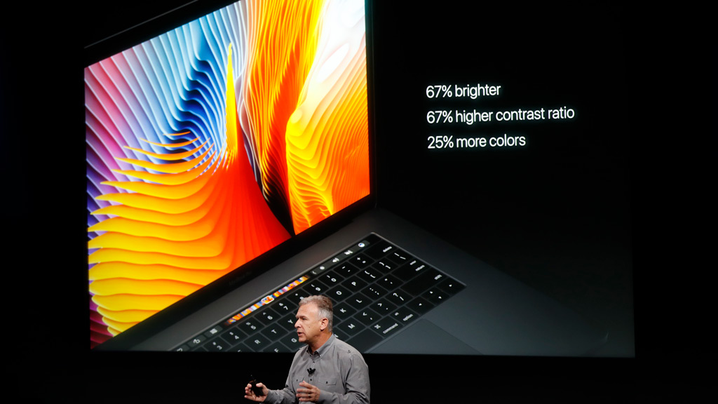 Apple Senior Vice President of Worldwide Marketing Phil Schiller introduces the all-new MacBook Pro during a product launch event on October 27, 2016 in Cupertino, California. (AFP)