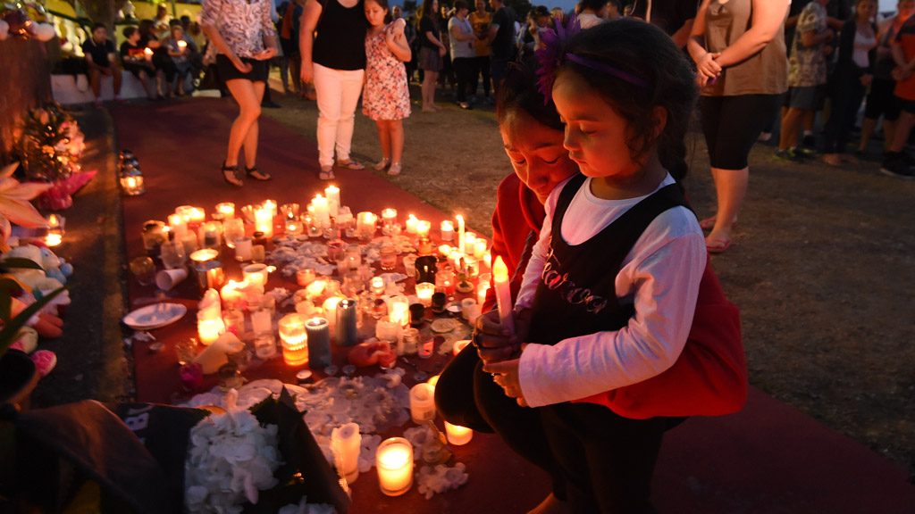 Mourners attend a candlelight vigil outside Dreamworld on October 28, 2016. (AAP)