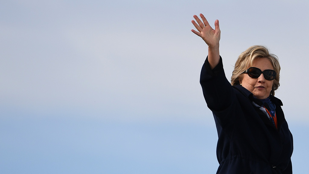 US Democratic presidential nominee Hillary Clinton waves as she boards her campaign plane at the Westchester County Airport in White Plains, New York, on October 29, 2016. (AFP)