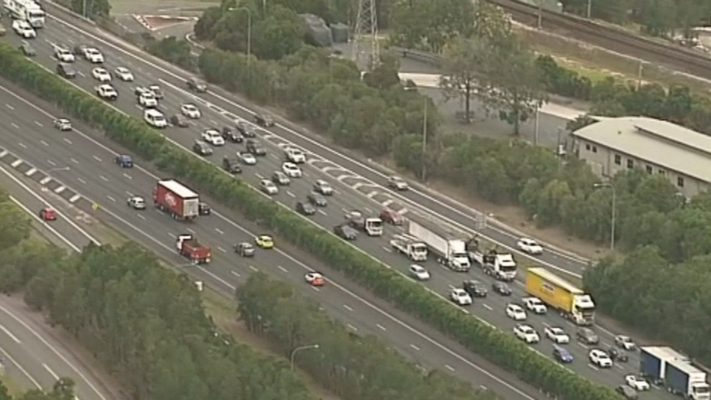 Truck rollover causes lengthy delays for commuters south of Brisbane