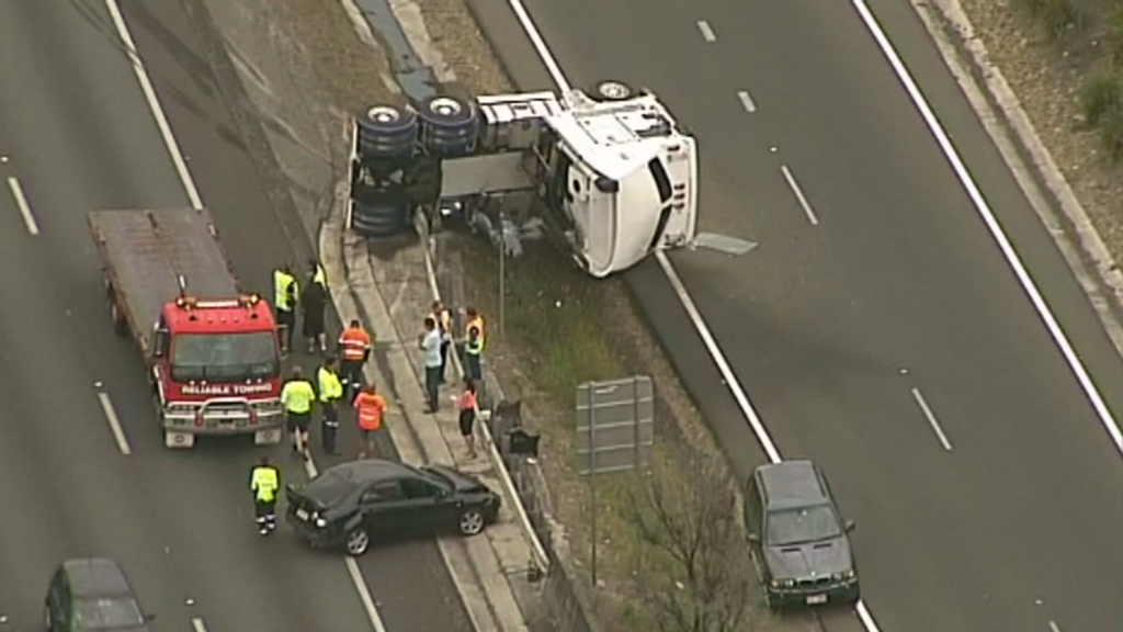 A truck has rolled and at least another two vehicles are believed to have been involved.