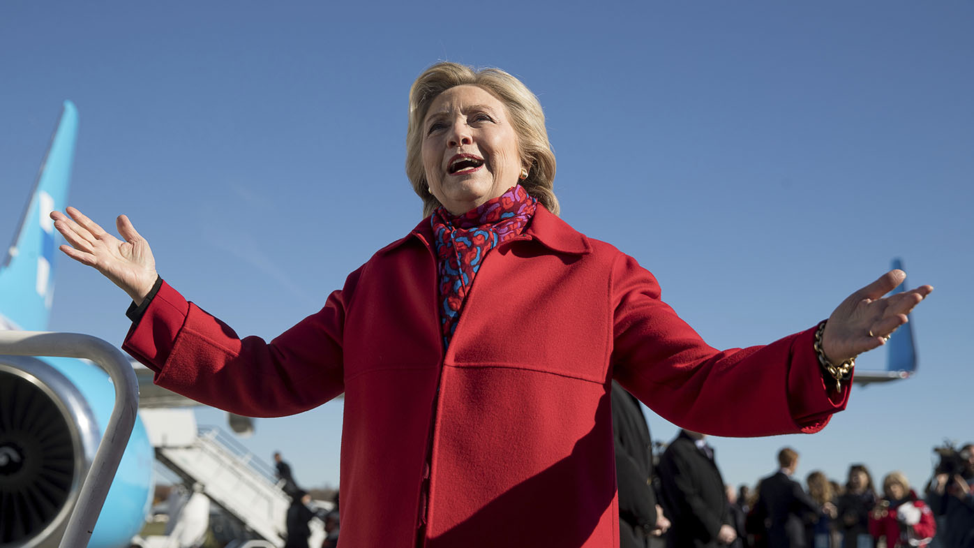 Hillary Clinton speaks to members of the media before boarding her campaign plane at Westchester County Airport in White Plains, New York. (AAP)