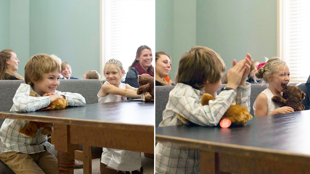 Two children grin after a judge announces their successful adoption by a foster family. (Facebook/Love What Matters/Heather Nelson)