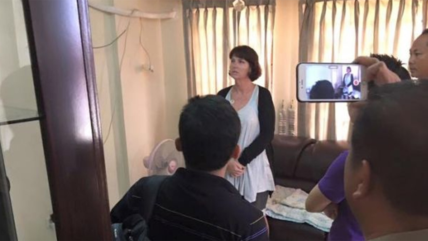 Tammy Davis-Charles being questioned by police. (Cambodian National Police)
