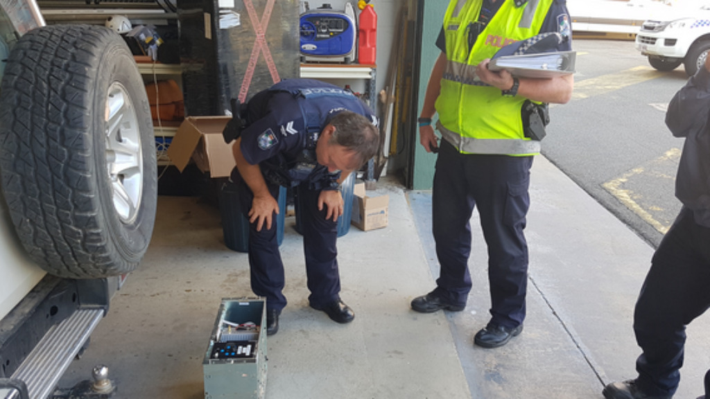 RES officers inspect the radio terminal. (Queensland Police)