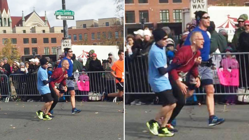 Marathon runners stop to help struggling man cross finish line