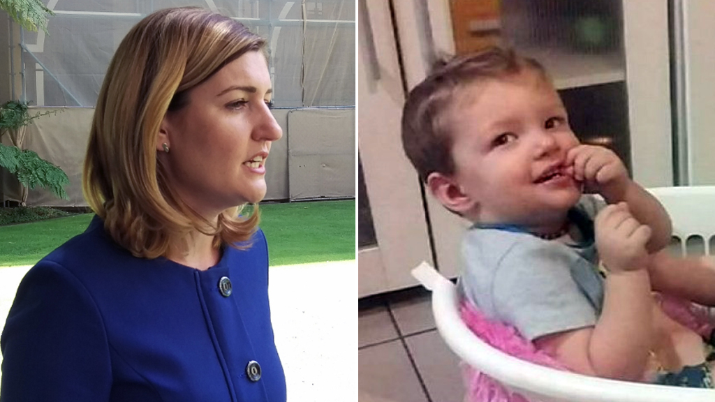 Child Safety Minister Shannon Fentiman, and toddler Mason Lee. (AAP)