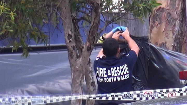 Authorities assess the scene. (9NEWS)