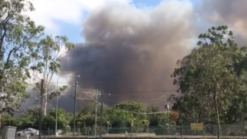 A primary school north of Brisbane has been evacuated as two grass fires burn nearby. (Twitter via Jarred Maunder)