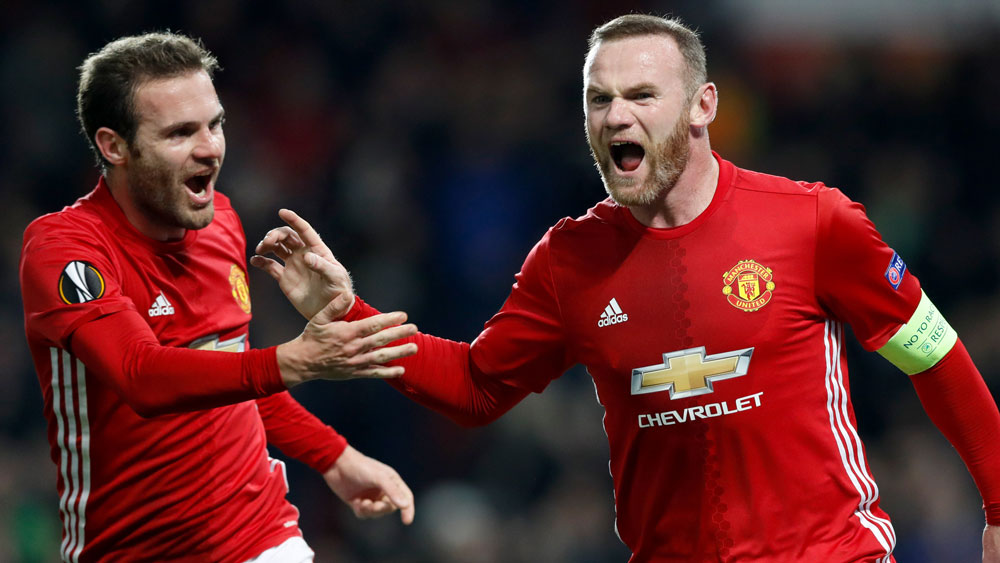 Rooney claims record, hits out at UK media